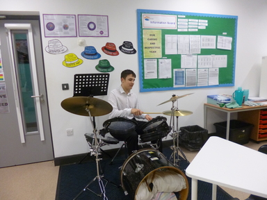 6th form student playing drums Nov 17