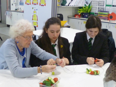 Hensioners and 6th form students making fruit for Hens Nov 17