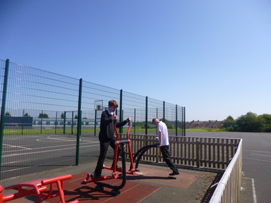 Pupils using outdoor gym equipment
